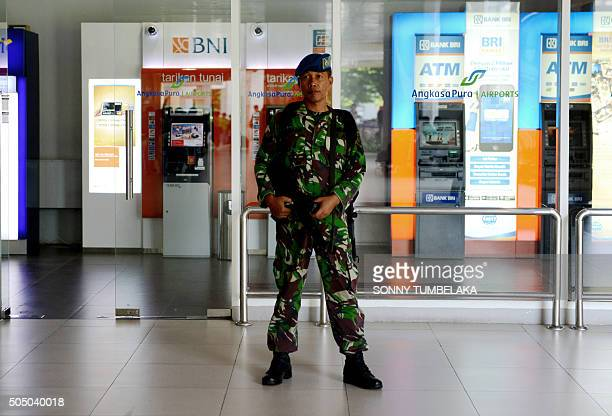 An Indonesian Air Force personnel stands on patrol at Ngurah Rai Airport in Denpasar on Indonesia's resort island of Bali on January 15 one day after...