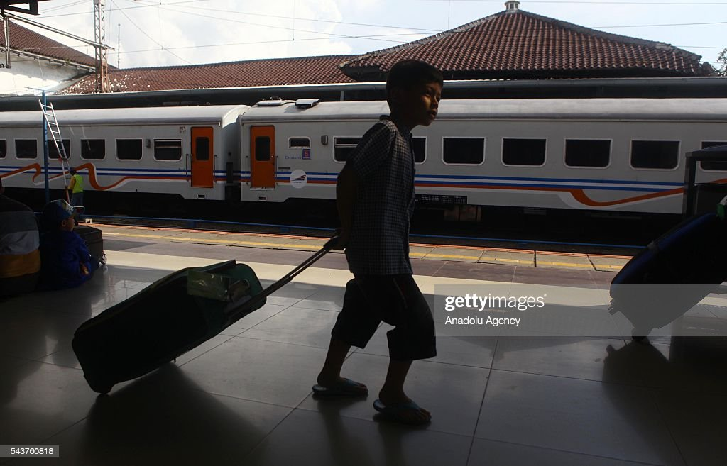 An Indonesian boy prepares to depart from their hometown, ahead of the Muslim Eid al-Fitr holiday, at Pasar Senen train station in Jakarta, Indonesia on June 30, 2016. Millions of people back to their hometown from Indonesia' s capital Jakarta to celebrate Eid-al-Fitr with their families and marking the end of the holy month of Ramadan.
