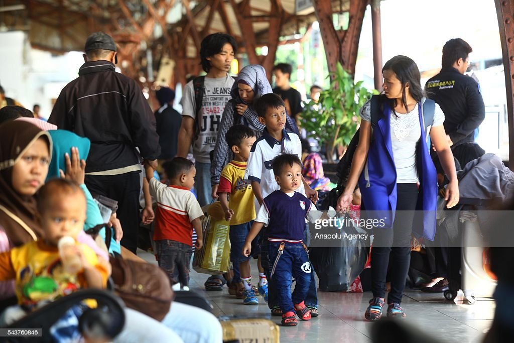 An Indonesian family prepares to depart from their hometown, ahead of the Muslim Eid al-Fitr holiday, at Pasar Senen train station in Jakarta, Indonesia on June 30, 2016. Millions of people back to their hometown from Indonesia' s capital Jakarta to celebrate Eid-al-Fitr with their families and marking the end of the holy month of Ramadan.