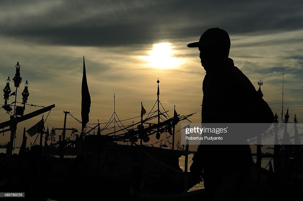 An Indonesian fisherman walks dawn on the beach at Muncar Port on May 25, 2014 in Banyuwangi, Indonesia. Indonesia has become one of the major exporters of meat and shark fins in the world, producing 640 thousand tons per year. The Indonesian government is tightening regulations for the fishing of sharks and manta rays, which are now included in the list of Appendix II of the Convention on International Trade in Endangered Species (CITES).