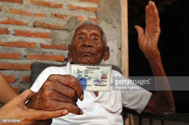 An Indonesian man named Mbah Gotho claimed to be 146 years old is the oldest human in world's history shows his identity card to press members at his...