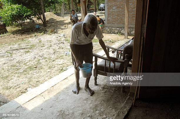 An Indonesian man named Mbah Gotho claimed to be 146 years old is the oldest human in world's history walks into his own house during an interview...