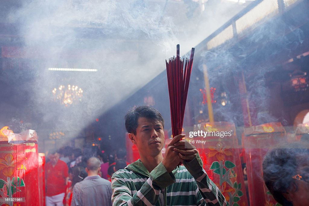 An Indonesian man of Chinese descent prays in the smoke filled Vihara Dharma Bhakti temple on the first day of the Chinese Lunar New year February 10, 2013 in Jakarta, Indonesia. Chinese people around the world are ushering in the Year of the Snake with prayers, feasts and fireworks.