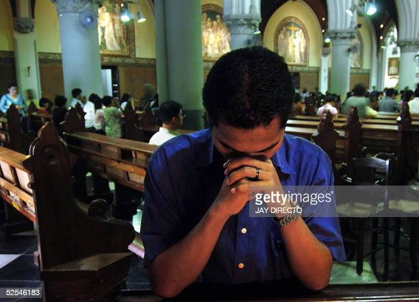 An Indonesian man prays for the Pope in a Jakarta church 01 April 2005 Pope John Paul II received the last rites 31 March 2005 evening after...