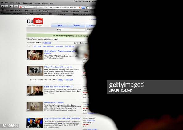 An Indonesian man searches for the antiIslam film Fitna at the YouTube website using his office computer in Jakarta on April 3 2008 Indonesia will...