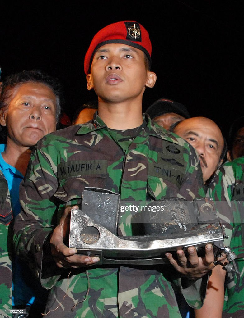 An Indonesian military officer displays the charred black box of the Russian Sukhoi Superjet 100 Russia's first postSoviet civilian aircraft at the...