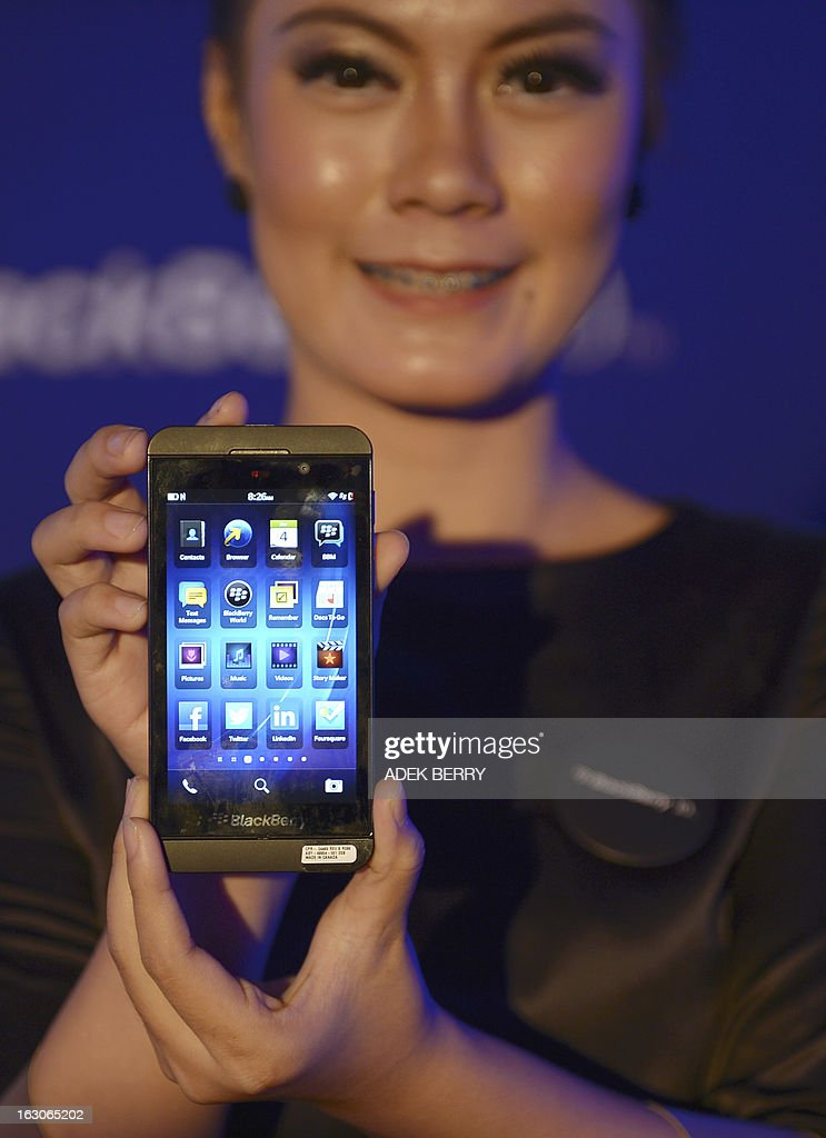 An Indonesian model holds a Blackberry Z10 in Jakarta on March 4 2013 The new BlackBerry Z10 was launched in Jakarta on March 4 and will be available...