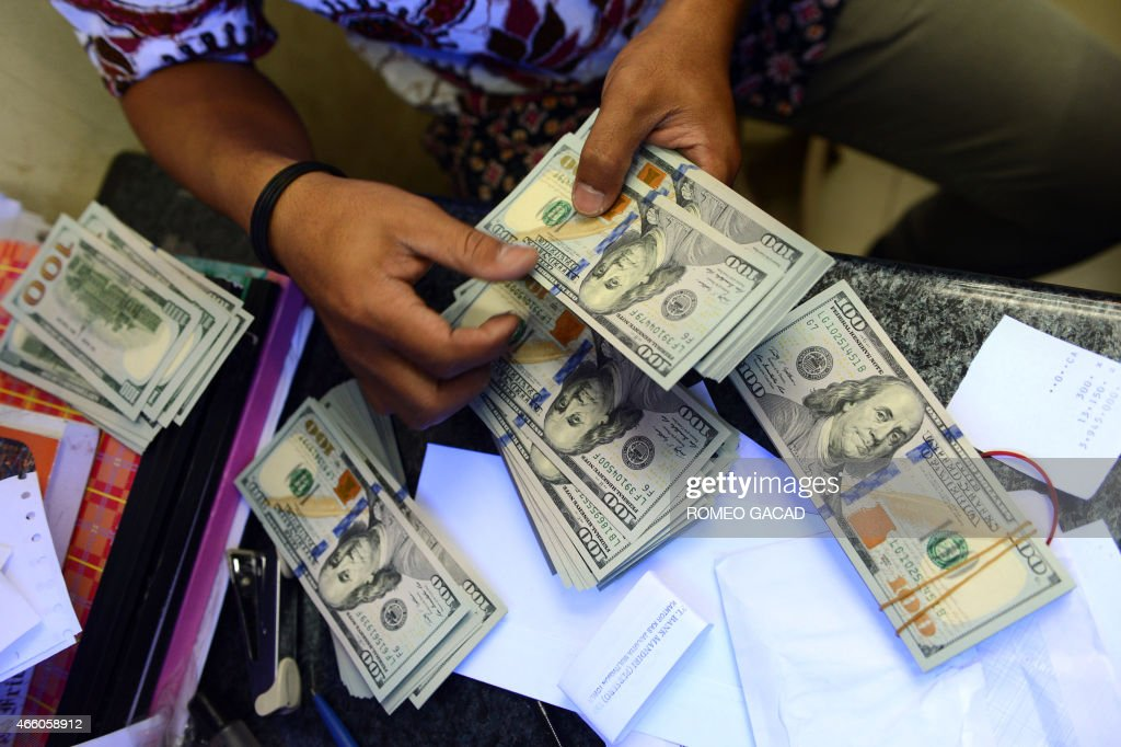 An Indonesian money changer sorts US dollar bills in Jakarta on March 13 2015 According to reports the rupiah continued its decline with the rates at...