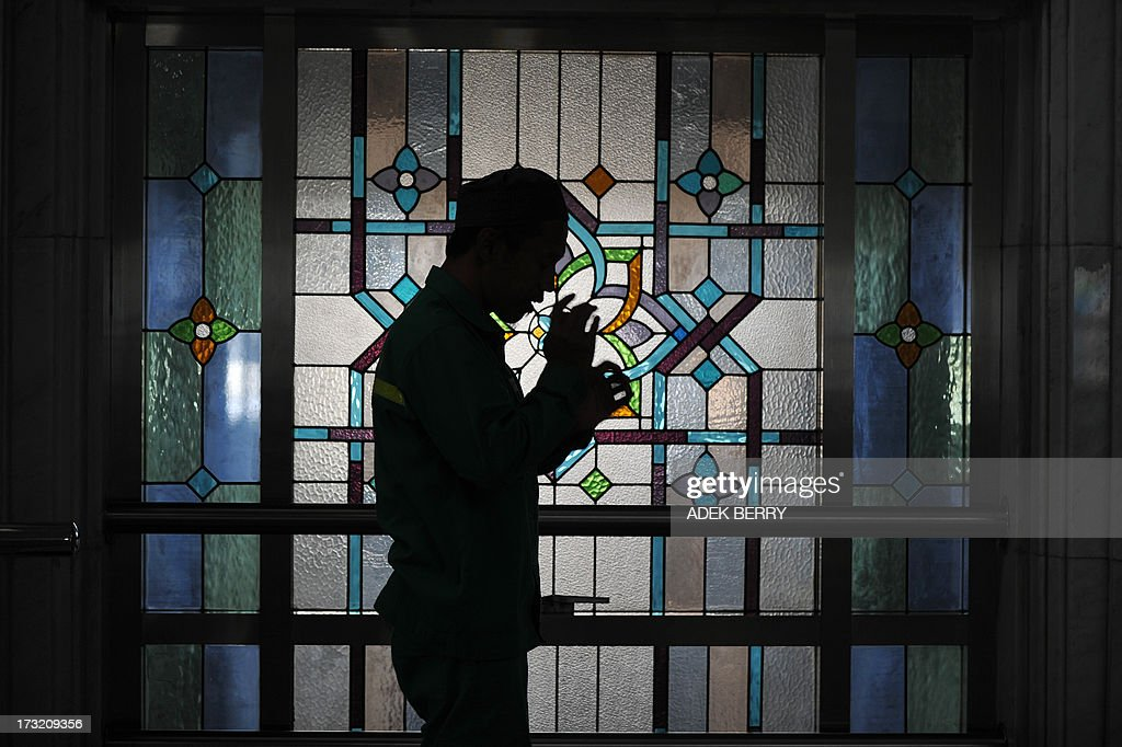 An Indonesian Muslim man prays at a mosque on the first day of the holy month of Ramadan in Jakarta on July 10, 2013. Islam's holy month of Ramadan is celebrated by Muslims worldwide marked by fasting, abstaining from foods, sex and smoking from dawn to dusk for soul cleansing and strengthening the spiritual bond between them and the Almighty.