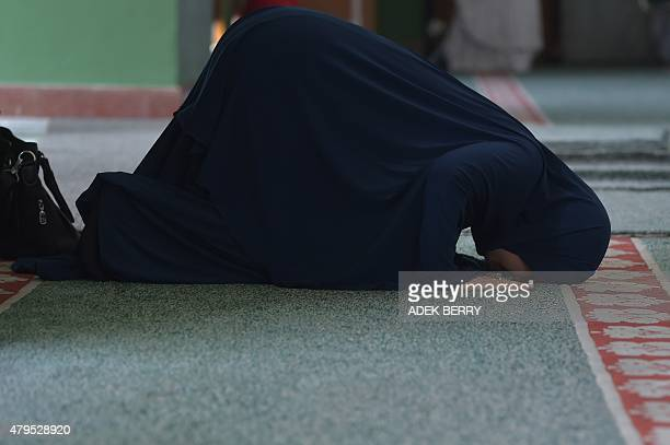An Indonesian Muslim woman offers prayers at a mosque during Ramadan in Jakarta on July 5 2015 More than 15 billion Muslim around the world are...