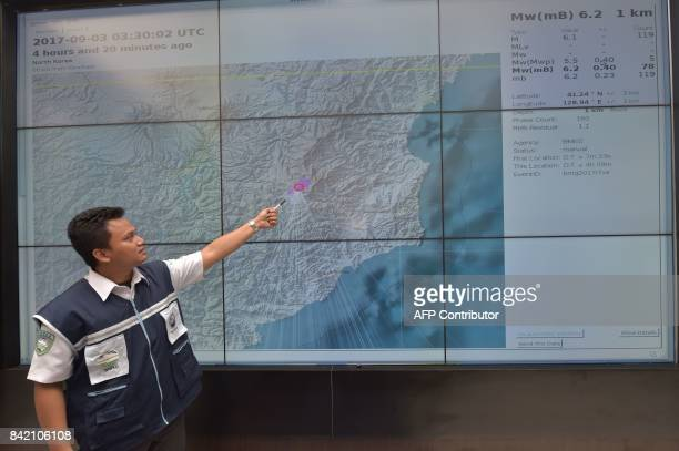 An Indonesian official at Indonesia's Meterological Climatological and Geophysical Agency in Jakarta points to a map of North Korea showing where the...