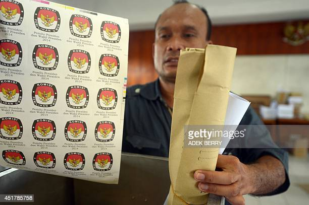 An Indonesian official checks election materials at a local election office in Jakarta on July 7 2014 Indonesians vote on July 9 in the country's...