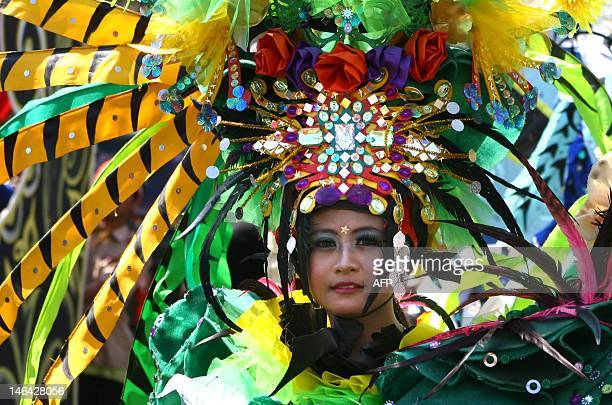 An Indonesian participant dressed in colorful costume parades during the annual Urban Culture Festival in Malang in East Java province on June 16...