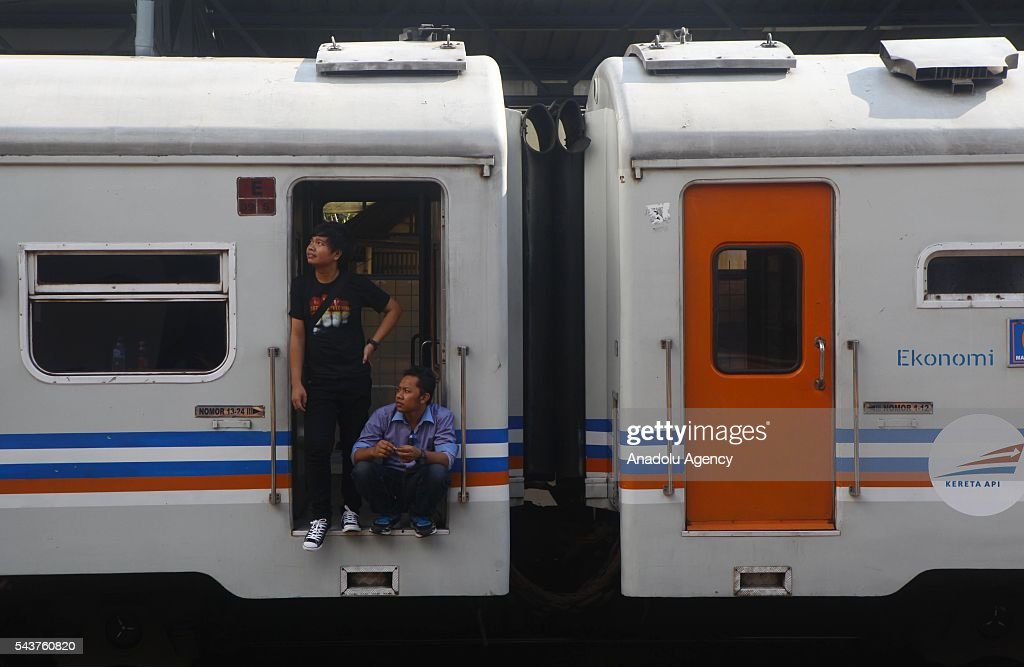 An Indonesian people prepare to depart from their hometown, ahead of the Muslim Eid al-Fitr holiday, at Pasar Senen train station in Jakarta, Indonesia on June 30, 2016. Millions of people back to their hometown from Indonesia' s capital Jakarta to celebrate Eid-al-Fitr with their families and marking the end of the holy month of Ramadan.