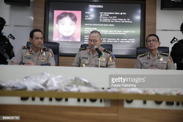 An Indonesian police official holds up an evidence bag containing shrapnel from a pressure cooker during a press conference and media presentation of...