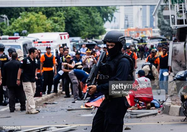 An Indonesian policeman stands guard in front of a blast site at the Indonesia capital Jakarta on January 14 2016 in Jakarta Indonesia Reports of...