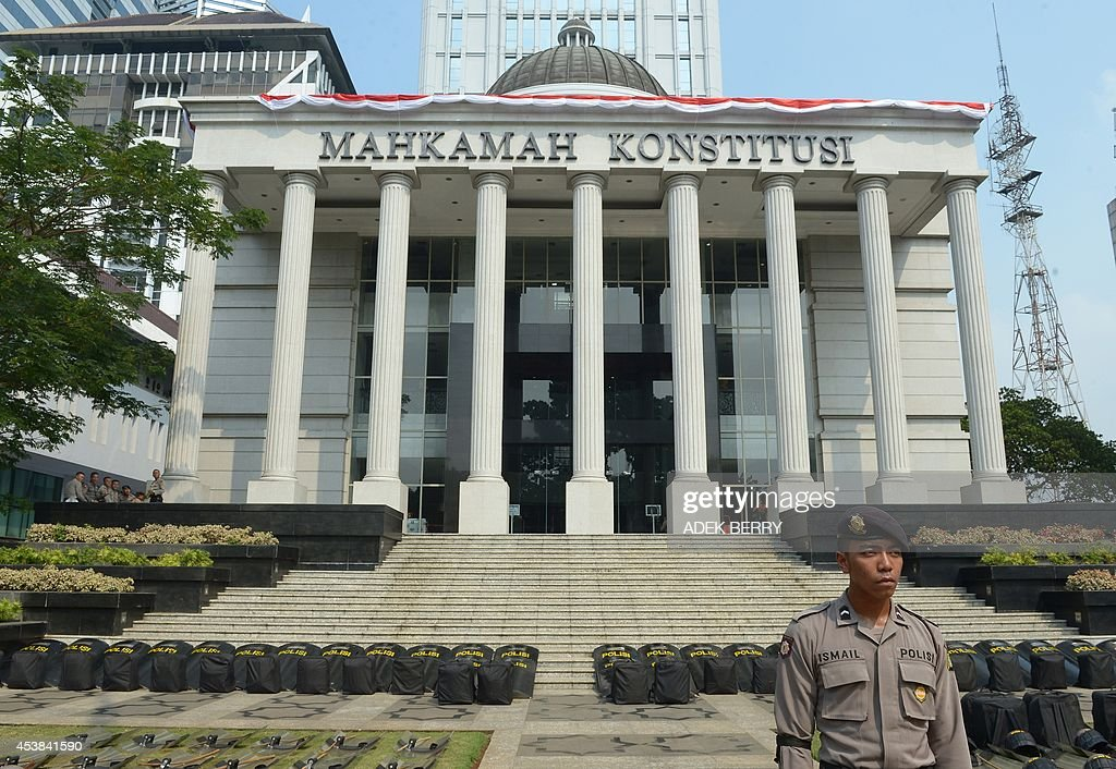 An Indonesian policeman stands guard outside the Constitutional Court in Jakarta on August 20, 2014, as authorities increase the security ahead of the announcement on August 21 of its decision about the presidential election dispute. Indonesian ex-general Prabowo Subianto angrily claimed widespread cheating cost him victory in the country's presidential election at the start of legal challenge to the results on August 6. Prabowo, a controversial former military figure with roots in the era of dictator Suharto, also declared victory at the July 9 presidential election, but official results two weeks later confirmed Joko Widodo won a decisive victory.