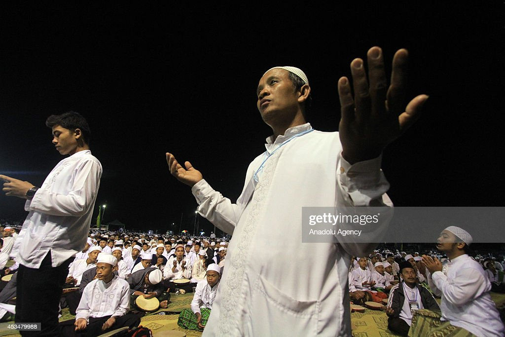 An Indonesian prays as more than 50,000 Indonesian Muslims gathered in Solo, to protest against the attacks of the Islamic state in Iraq and Syria (ISIS), on August 10, 2014 in Solo, Central Java, Indonesia.