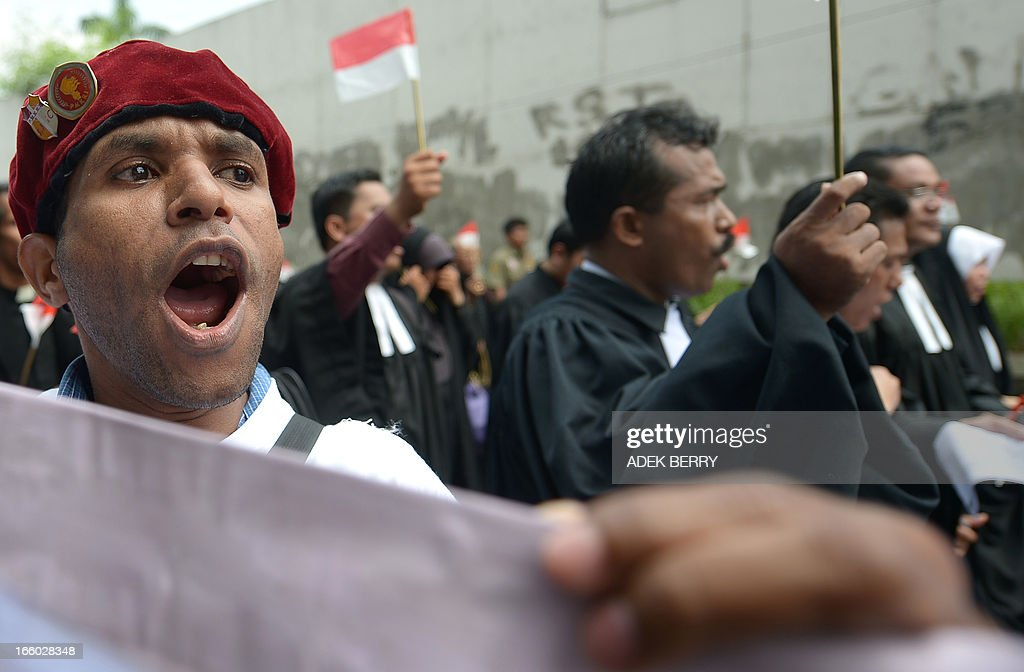 An Indonesian protester shouts slogans as religous leaders protest against Indonesian government failures to guarantee freedom of religion in Jakarta on April 8, 2013. Around 200 Indonesian minority leaders protested against religious intolerance and discrimination in the Muslim-majority country. The group representing Christians, Ahmadiyah and Shiite Islamic minority sects gathered outside the parliament, singing the country's national anthem and shouting 'We have rights' and 'Stop intolerance'.