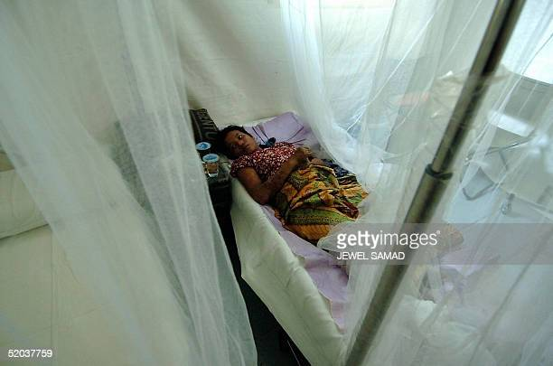 An Indonesian tsunami disaster survivor recovers in a field hospital run by German soldiers in Banda Aceh 20 January 2005 The Indonesian death toll...