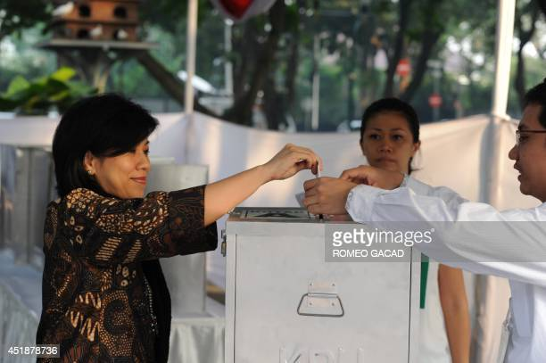 An Indonesian voter casts her ballot at a polling center in Jakarta on July 9 2014 Indonesians vote on July 9 in the country's most pivotal...