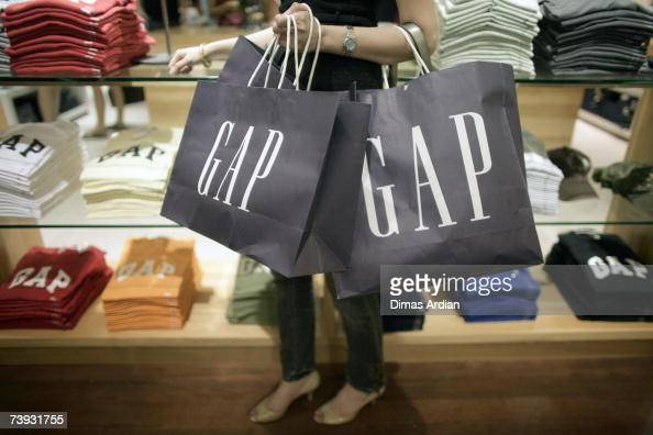 An Indonesian woman carrys GAP shopping bags as GAP opens their first store in Indonesia at Senayan City shopping mall on April 20 2007 in Jakarta...