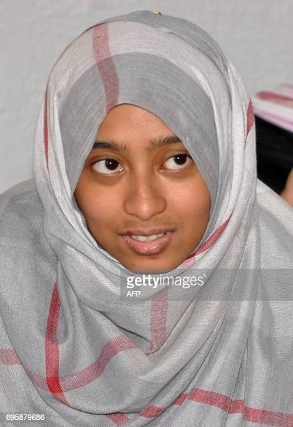 An Indonesian woman sits in a room following her arrival at the Ain Issa camp 50 kilometres north of Raqa after fleeing the Islamic State group's...