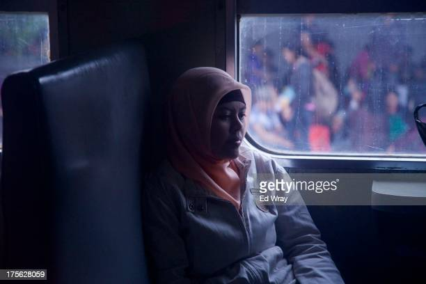 An Indonesian woman sits in a train which will take her to her home village for the August 8 Eid al Fitr holiday on August 5 2013 in Jakarta...
