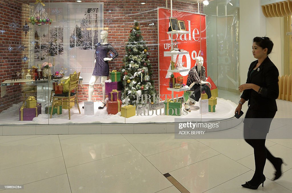An Indonesian woman walks inside a mall decorated with Christmas ornaments in Jakarta on December 22, 2012. Many shopping malls and business centres in Indonesia, the largest Muslim-majority nation in the world, are decorated with Christmas ornaments to welcome Christmas and New Years.
