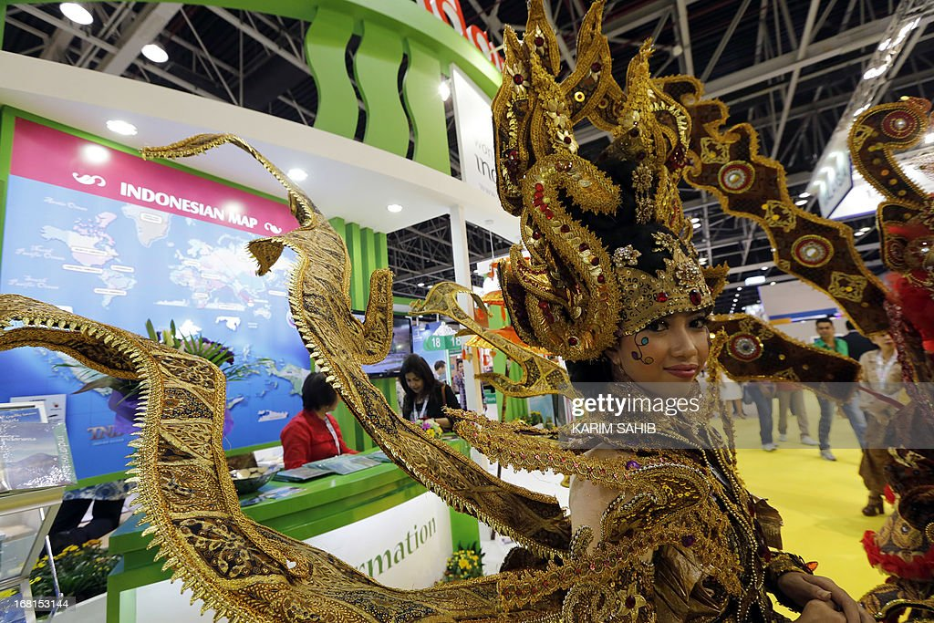 An Indonesian woman wearing her country's traditional costume welcomes visitors at the Indonesia stand during the 2013 Arabian Travel Market (ATM) exhibition in Dubai on May 6, 2013.