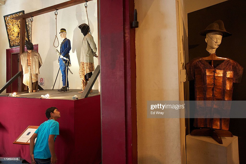 An Indonesian youth looks at information related to a tableau at the National History museum in Kota Tua Sunday June 16, 2013 in Jakarta, Indonesia. Once known as the 'Queen of the East', Kota Tua, which means Old Town in Indonesian, is the original city of Jakarta built by the Dutch in the 16th century and called Batavia at that time. Currently, Kota Tua's beautiful Colonial architecture is in ruins, abandoned as the city edged farther south over the years. Jakarta's Governor, Joko Widodo, hopes to make it a priority to restore the old town and develop it into a high end tourist destination..