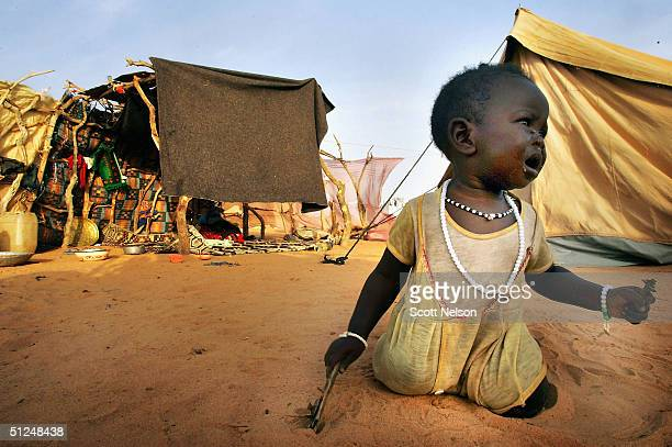 An infant refugee from the Darfur region of Sudan cries for her mother near her tent in the Oure Cassoni refugee camp on August 31 2004 in Oure...