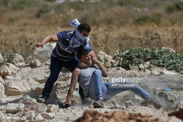 TOPSHOT An Infiltrated undercover member of the Israeli security forces detains a Palestinian protester during clashes near the Jewish settlement of...