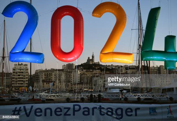 An inflatable '2024' logo is seen in the old harbour area of Marseille late September 13 during celebrations after the International Olympic...