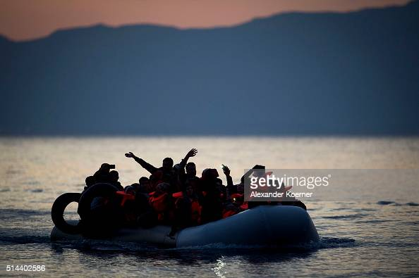 An inflatable boat is seen while arriving at the shore crossing the sea from Turkey to Lesbos some 5 kilometres south of the capital of the Island...