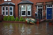 An inflatable boat sits on the front steps of a house in Carlisle north west England on December 7 after heavy flooding caused by Storm Desmond...