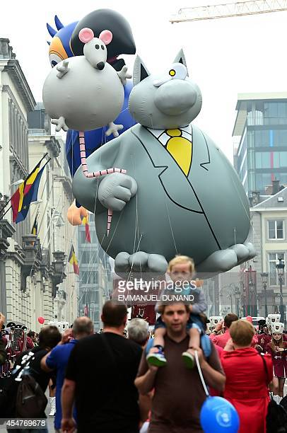 An inflatable of Belgian comic strip character Le Chat is paraded during the Balloon's Day Parade as part of the annual Comic Book Festival in...