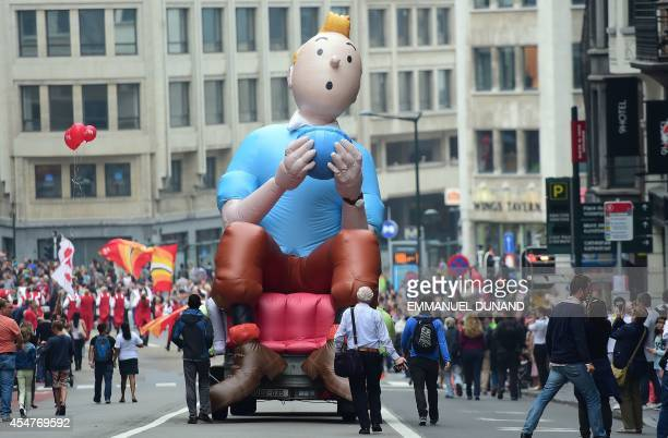 An inflatable of Belgian comics series character Tintin is paraded during the Balloon's Day Parade as part of the annual Comic Book Festival in...