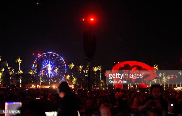 An inflatable pig floats over the crowd at Roger Waters' performance during Desert Trip at the Empire Polo Field on October 16 2016 in Indio...