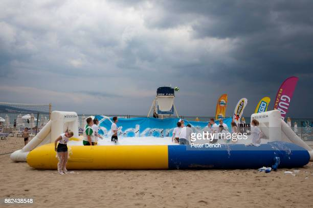 An inflatable pool with goals at either end is filled with foam on the beach for a party organised at Sunny Beach Bulgaria by promotional...