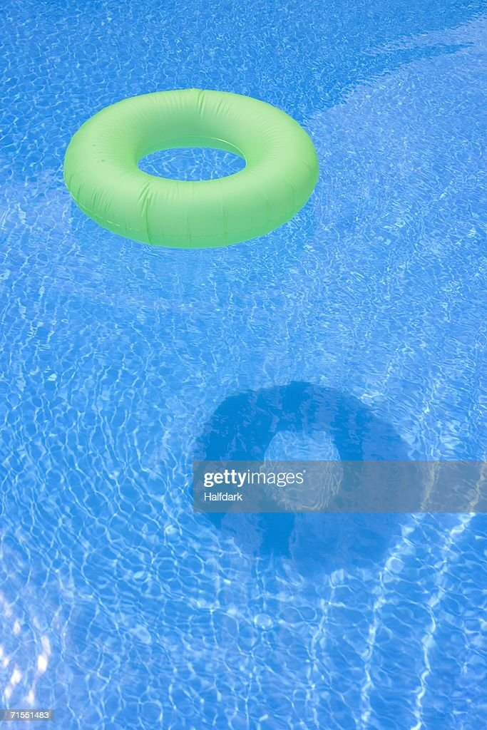 An inflatable ring floating in a swimming pool