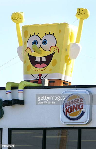 An inflatable SpongeBob SquarePants sits on the roof of a Burger King December 3 2004 in Wichita Kansas The inflatable Sponge Bob has been popular...