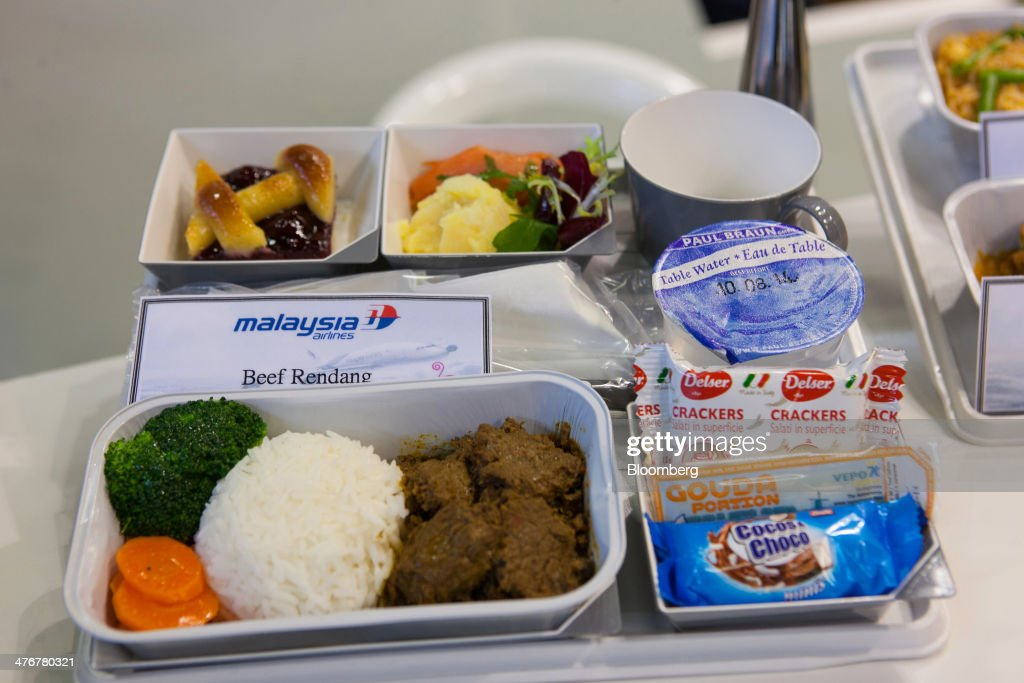 An in-flight meal for Malaysia Airline System Bhd. is presented on a tray during the ITB Berlin tourism fair at Messe Berlin exhibition center in Berlin, Germany, on Wednesday, March 5, 2014. Archaic rules, taxes as high as those imposed on alcohol and an infrastructure deficit, especially in Asia, are curbing the aviation industry's growth, the International Air Transport Association said. Photographer: Krisztian Bocsi/Bloomberg via Getty Images