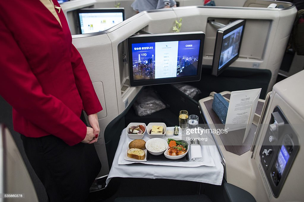 An in-flight meal is arranged in a business-class seat onboard an Airbus Group SE A350-900 aircraft operated by Cathay Pacific Ltd. during a media event in Hong Kong, China, on Monday, May 30, 2016. Airbus stuck to plans to increase plane deliveries this year as it pushes to overcome a series of problems affecting production of its newest aircraft. Photographer: Justin Chin/Bloomberg via Getty Images