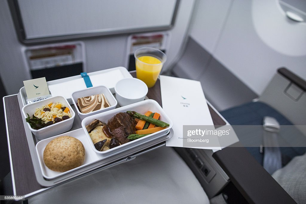 An in-flight meal is arranged in a economy-class seat onboard an Airbus Group SE A350-900 aircraft operated by Cathay Pacific Ltd. during a media event in Hong Kong, China, on Monday, May 30, 2016. Airbus stuck to plans to increase plane deliveries this year as it pushes to overcome a series of problems affecting production of its newest aircraft. Photographer: Justin Chin/Bloomberg via Getty Images