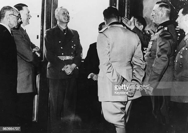 An informal meeting of Axis leaders Count Paul Teleki Adolf Hitler Ribbentrop Galeazzo Ciano Saburo Kurusu Field Marshal Keitel and Baldur von...