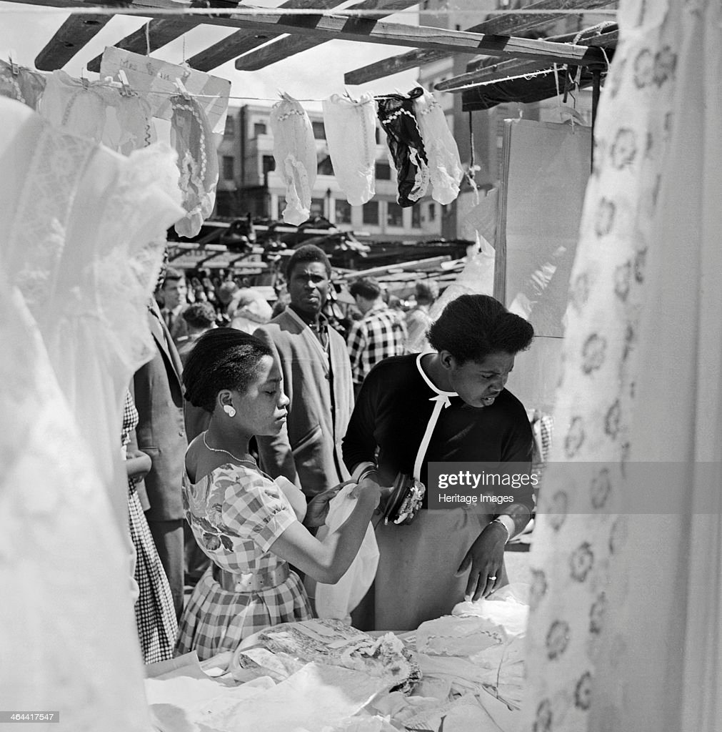 An informal portrait of two women looking at a stall in the Petticoat Lane Market Whitechapel London c1946c1959