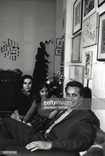 sitting on a sofa are Ottavio the wellknown fashion designer with his wife Rosita and their daughter Angela Italy 1968