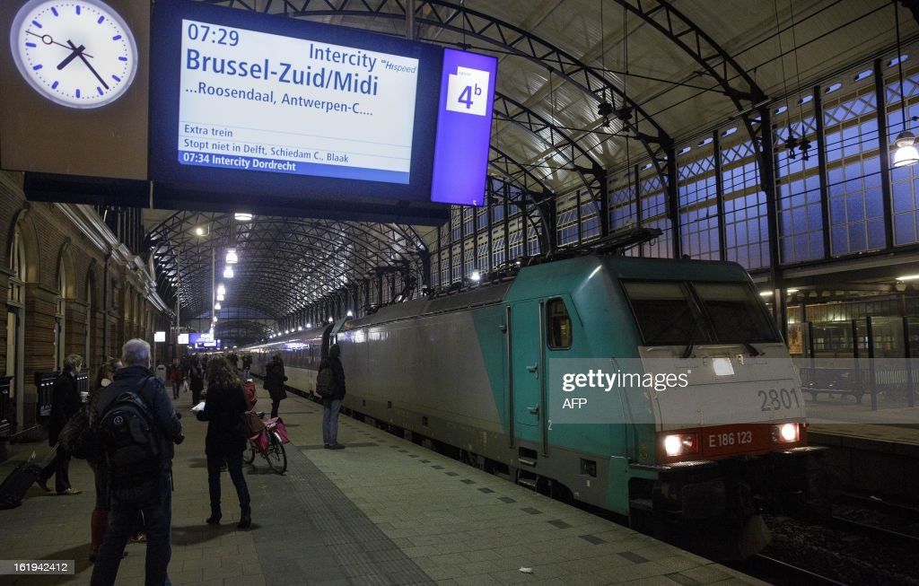 An information board above the platform on station Hollands Spoor announces the departure of the first direct train to Brussels from The Hague on February 18, 2013. As of today commuters can travel on the intercity train, operating twice daily,and which replaces the high-speed Fyra trains. The Fyra trains used between Amsterdam and Brussels are out of function since 17 January due to numerous problems culminating mid January with cancellations due to safety issues. AFP PHOPTO / ANP PHIL NIJHUIS netherlands out