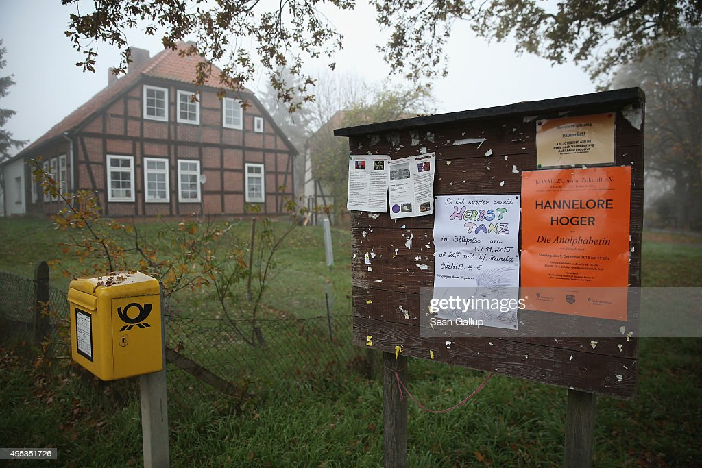 An information board hosts flyers for local events next to a post office box on November 2, 2015 in Sumte, Germany. Sumte, a farming village located southwest of Hamburg, has a population of 102, and starting later today it is to receive 500 migrants who will be housed in an abandoned office park on the village edge. The number of migrants at the shelter could reach up to 750 in coming weeks as Germany struggles to accommodate the unrelenting flood of migrants arriving at a rate of thousands per day. Authorities are distributing migrants seeking asylum in Germany at shelters nationwide, both in urban centers and in small, rural communities.